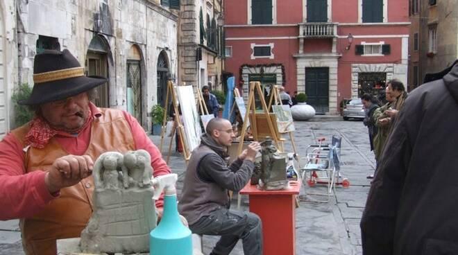 Gli artisti del borgo all'opera